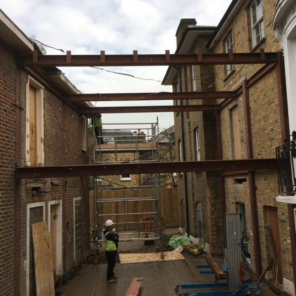 Steel Beams connecting one building to another, Brixton London